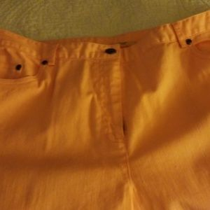 Peach colored cropped pants.